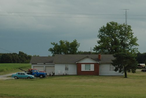 A nice house with a selection of colourful cars and trucks. Missouri (2007)