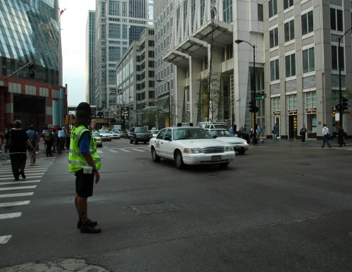 A woman helps direct traffic… even though there were traffic lights there. Chicago (2007)