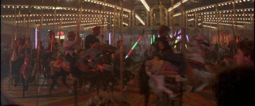 The scene of the merry-go-round in The Lost Boys movie… see the similarity? The Lost Boys (1987)
