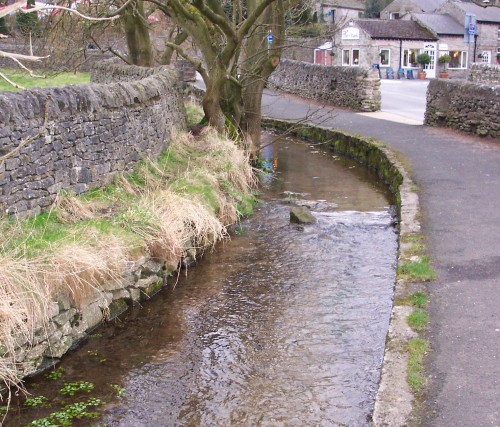 A clean and pretty stream flows through a nice village, Peak District (2006)