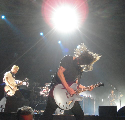 Dave thrashes the guitar at the front of the stage. Nottingham (2007)