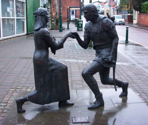 Robin Hood introduces himself to Maid Marian on the high street of a little village, Sherwood Forest (2006)