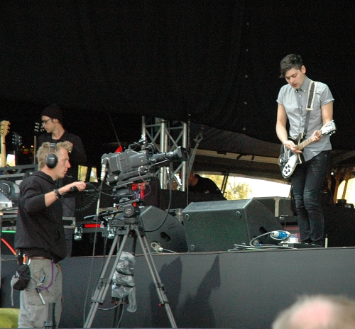 A camera man makes sure the crowd catch every detail of Chris Urbanowicz's guitar playing. Manchester (2008)