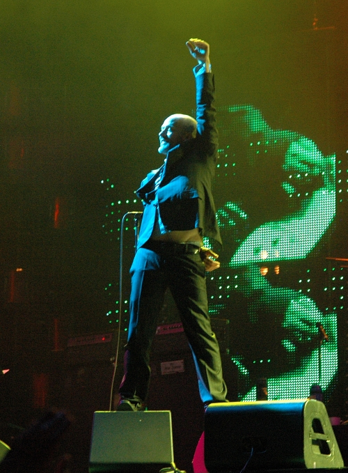 Michael Stipe shows the crowd how big he wanted to be when he grew-up. We also got to see a glimpse of his underpants. Manchester (2008)