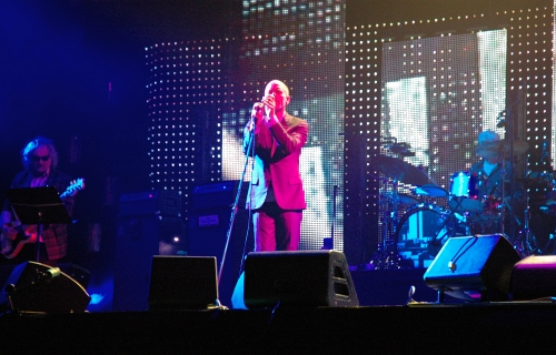 Michael Stipes stands in the pretty pink lights. Manchester (2008)