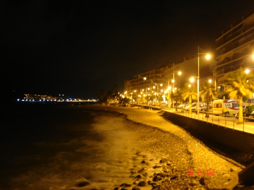 The beach and restaurants on the sea front of Altea at night, Spain (2006)