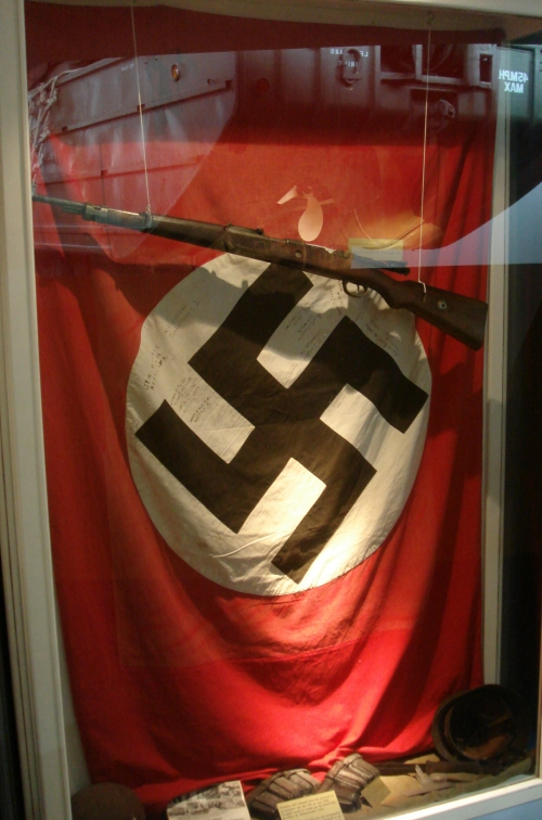 An authentic Nazis flag and rifle, the flag is signed, France (2006)