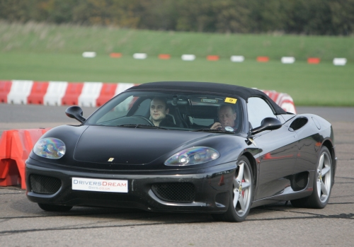 Driving a Ferrari Spyder 350 under the instruction of some geezer I didn't really pay attention too, Bruntingthorpe proving ground (2006)
