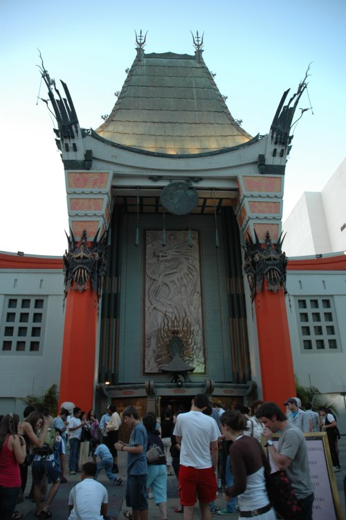 The front of Mann's Chinese Theatre. Lots of people looking at the prints left by celebrities. Los Angeles (2007)