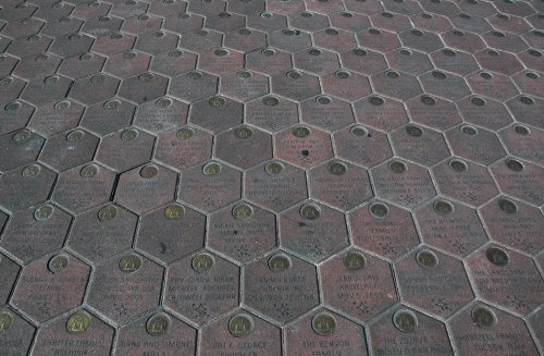 You can have you name and message engraved on the thousands of paving stones outside the entrance to the Disney theme parks. Los Angeles (2007)