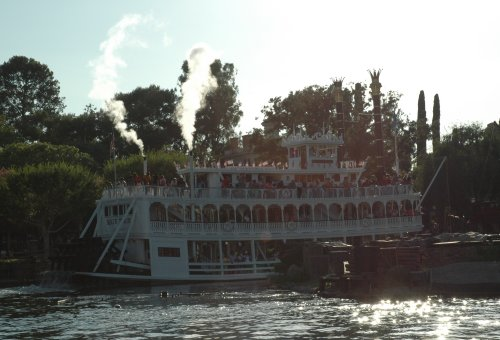 An old fashioned steamboat steams around the lake at Disneyland. Los Angeles (2007)