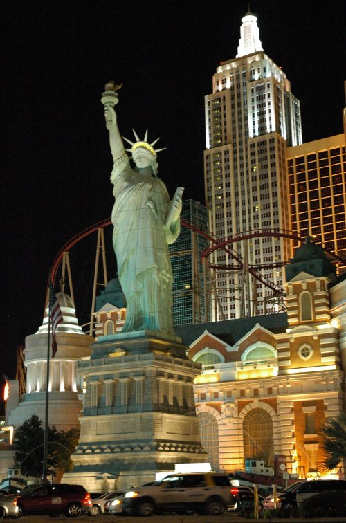 Replica Statue of Liberty with the famous rollercoaster on top of the casino in the background. Las Vegas (2007)